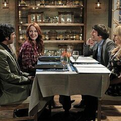 Emily and Raj having dinner with Howard and Bernadette.