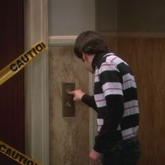 Howard vainly tries to fix the elevator.