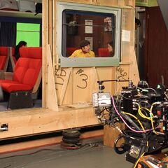 Behind the scenes on their train set.