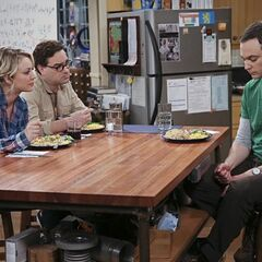 Dinner table with Sheldon, Penny and Leonard.