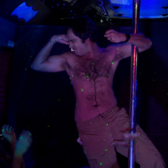 Raj using the stripper pole.