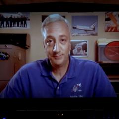 Astronaut Mike giving Howard pessimistic advice.