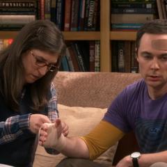 Amy helping Sheldon.