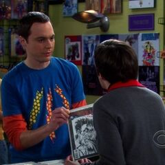 Sheldon and Howard fighting over a comic book.