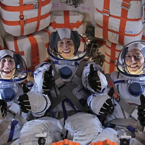 Expedition 31 crew in Soyuz capsule.