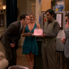 Sheldon blowing out his candles.