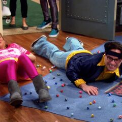 Leonard and Penny slip on marbles
