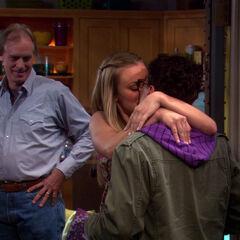 Penny kissing Leonard for her father's sake.
