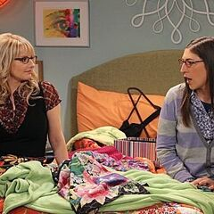 Amy and Bernadette sit on Penny's bed and talk as they wait for Penny to try out clothes for her date.