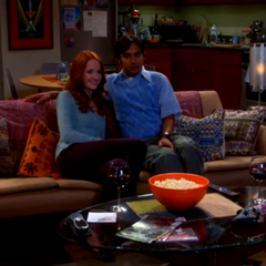 Emily and Raj enjoying a scary movie together.