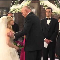 Mr Rostenkowski prepares to give Bernadette over to Howard at the altar.