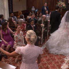 Penny and Leonard following down the aisle.