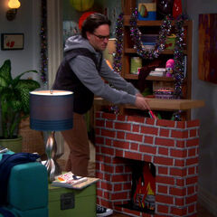 Leonard building a fireplace with his own two hands.