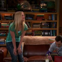 Penny sitting down to have dinner with Sheldon.