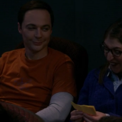 Sheldon and Amy passing science notes.