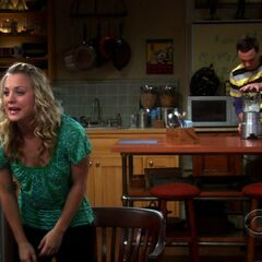 Penny fighting with Leonard as Sheldon drowns out the noise.