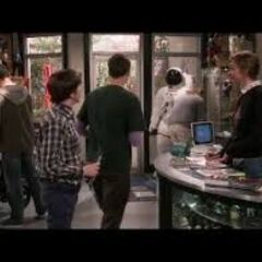 Sheldon escaping the comic book store's change.