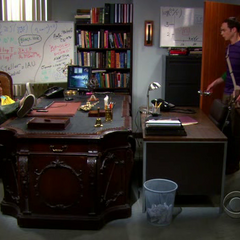Sheldon comes upon Raj's big ass desk.