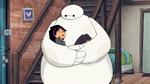 Go Go sleeps in Baymax's arms
