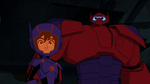 Hiro and Baymax look at robot