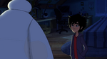 Hiro looks at sleeping Baymax