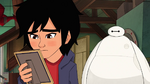 Hiro looks at photograph