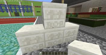 BOP abbreviation in white chiseled sandstone
