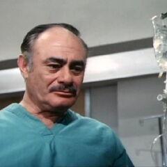 Martin Balsam as the first Rudy Wells