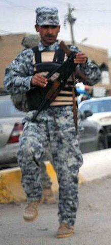 File:Police soldier with gun.jpg