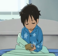 Hiro stares at his alarm clock in the morning.