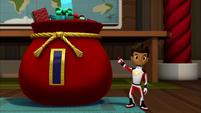 S2E6 AJ presenting Santa's bag