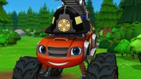 S2E1 Blaze admires his firefighter helmet