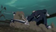 Ichigo thrown across the ground by Reigai-Ikkaku