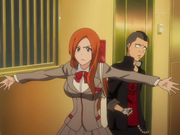 Orihime protegiendo a Shishigawara