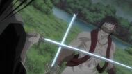 Byakuya blocks Kōga's attack.