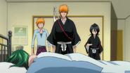 Ichigo, Rukia and Kon stand over the girl's body