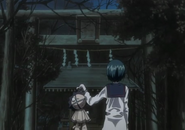 Kon and Nozomi at the gate