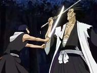 Kenpachi blocking maki's attack