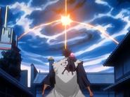 O25 Zaraki i Yachiru patrzą na rozbłysk na niebie
