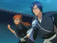 Ishida y Orihime vestidos de Shinigamis
