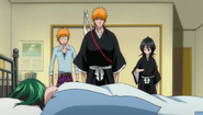 640px-Ichigo, Rukia and Kon stand over the girl's body