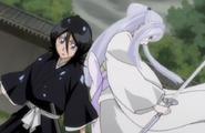 232Sode no Shirayuki appears behind Rukia
