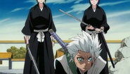 Reigai tower over a fallen Hitsugaya