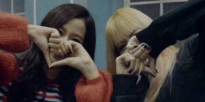 Jisoo and Lisa making hearts