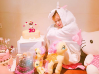 Lisa in her Unicorn Onesie on her Birthday