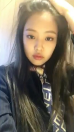 Jennie flicking her hair back