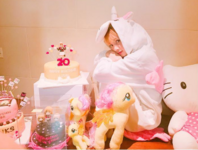 Lisa in her Unicorn Onesie on her Birthday 2