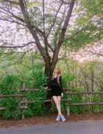 Lisa by a tree on Instagram