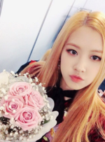 Rosé holding some roses
