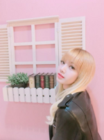Lisa next to a bookshelf